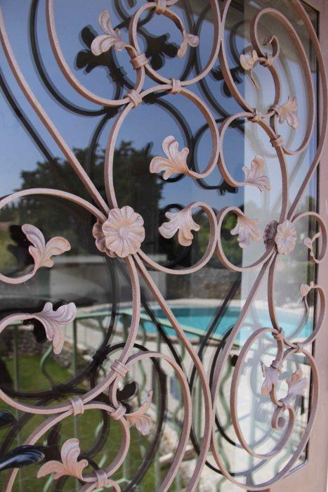 Porte vitrée en fer forgé